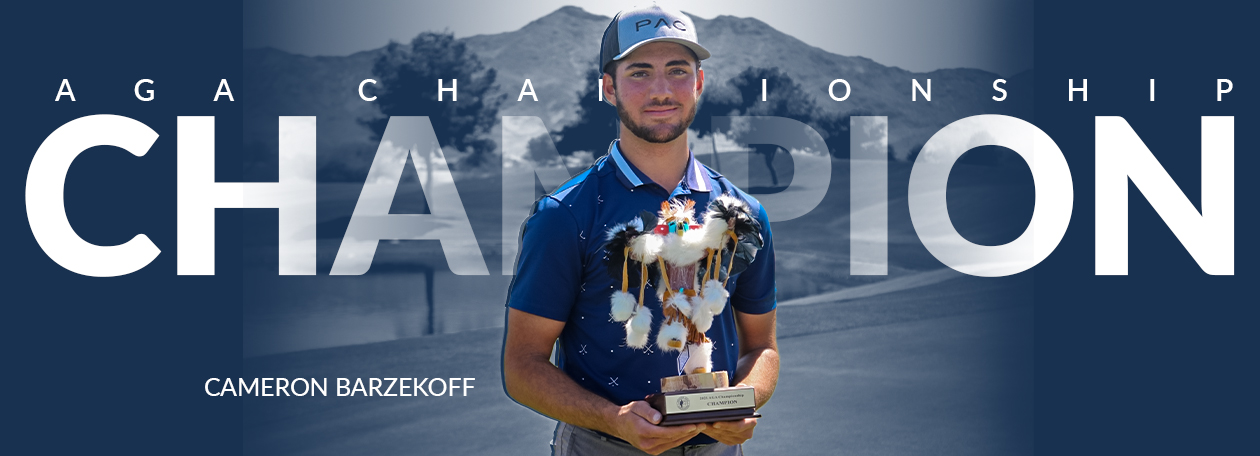 Cameron Barzekoff holding the AGA Championship Kachina trophy
